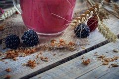 Delicious blackberry and raspberry smoothie, detox yogurt or mil Stock Photos