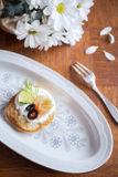 Delicious blintz with cream Royalty Free Stock Image