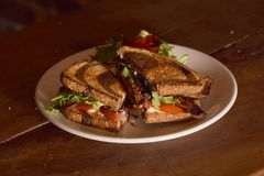 BLT Sandwich on Wooden Table royalty free stock photos