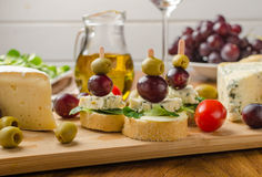 Delicious blue cheese with olives, grapes and salad Stock Image
