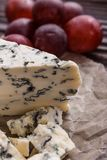 Delicious blue cheese on wooden rustic background.  stock photos