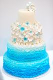 Delicious blue and white wedding cake Stock Image