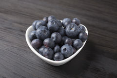 Delicious blueberries in white bowl. Fresh delicious blueberries in white bowl Royalty Free Stock Images