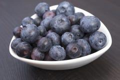 Delicious blueberries in white bowl. Fresh delicious blueberries in white bowl Royalty Free Stock Photos