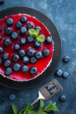 Delicious blueberry cake with fresh berries and marmalade, tasty cheesecake Stock Images
