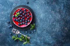 Delicious blueberry cake with fresh berries and marmalade, tasty cheesecake Royalty Free Stock Images