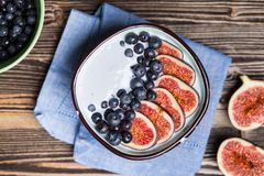 Delicious blueberry and fig yoghurt. Bowl stock photo