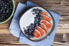 Delicious blueberry and fig yoghurt. Bowl royalty free stock image