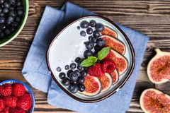 Delicious blueberry and fig yoghurt royalty free stock photography