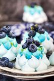 Delicious blueberry Pavlova meringue cakes decorated with cream royalty free stock photos