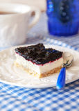 Delicious blueberry squares cake with whip cream Royalty Free Stock Image