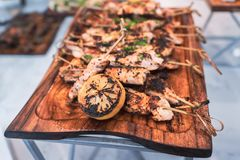 Delicious board of chicken skewers served with grilled lemon. stock photography