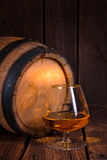 Delicious bourbon on a wooden barrel. A delicious bourbon on a wooden barrel royalty free stock images