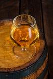 Delicious bourbon on a wooden barrel Royalty Free Stock Photos