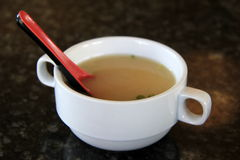 Delicious bowl of flavorful Miso soup. A favorite Vietnamese soup, with noodles in an aromatic broth, garnished with scallions, onions, and cilantro, set on Royalty Free Stock Photos