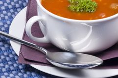 Delicious bowl of fresh made soup. A nice bowl of tomato soup with spoon on the side stock image
