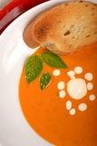 Delicious bowl of tomato soup with grilled bread and basil Royalty Free Stock Photography