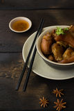 Delicious braised pig knuckles. In brown sauce Royalty Free Stock Photo