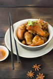 Delicious braised pig knuckles. In brown sauce Stock Image