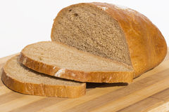 Delicious bread. On a board and cut into slices stock images