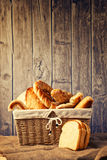 Delicious bread and rolls inwicker basket Stock Photos