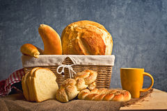 Delicious bread and rolls inwicker basket Stock Images