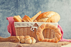 Delicious bread and rolls in wicker basket Stock Photo
