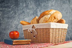 Delicious bread and rolls in wicker basket Royalty Free Stock Photo