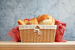 Delicious bread and rolls in wicker basket Royalty Free Stock Images