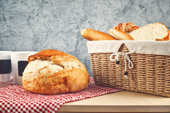 Delicious bread and rolls in wicker basket Royalty Free Stock Photography