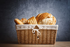 Delicious bread and rolls in wicker basket Royalty Free Stock Image