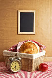 Delicious bread and rolls in wicker basket Stock Photography