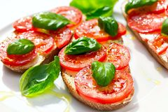 Delicious bread  with tomato and basil Royalty Free Stock Photo