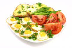Delicious breakfast. – quail eggs, vegetables and toasts with cheese Royalty Free Stock Photos