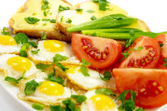 Delicious breakfast. – quail eggs, vegetables and toasts with cheese Royalty Free Stock Images