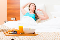 Delicious breakfast in bed for the girl Stock Photos