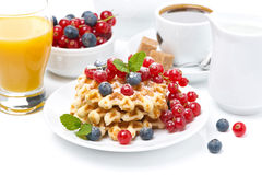 Delicious breakfast with Belgian waffles and berries, over white Stock Photography