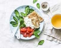 Delicious breakfast or brunch - crepes with smoked salmon, spinach and sour cream on a light background stock images