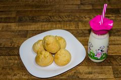 Delicious breakfast, cheese bread served with milk, traditional food of the State of Minas Gerais, Brazil stock images