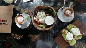 Delicious breakfast. Coffee and sandwiches and salad stock video