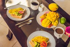 A delicious breakfast consisting of omelet, fruit and coffee.  stock photo
