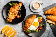 Croissant sandwiches with Fried Egg, Salad Leaves, Grilled Mushr Stock Photos