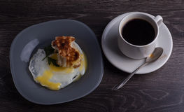 A delicious breakfast of eggs, coffee and griddle-cake Stock Photography