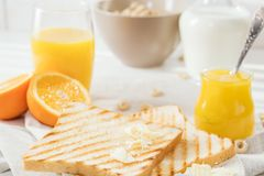 Delicious breakfast, french toasts with butter and honey,. Fresh oranges and juice Stock Photography
