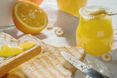 Delicious breakfast, french toasts with butter and honey,. Fresh oranges and juice Royalty Free Stock Image