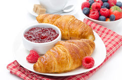 Delicious breakfast - fresh croissant with raspberry jam, coffee Stock Image