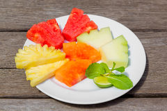 Delicious breakfast of fresh fruit on a plate - watermelon, melo Stock Photos