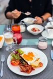 Breakfast with fried eggs. Delicious breakfast with fried eggs, bacon and vegetables Royalty Free Stock Photo