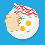 Delicious breakfast of fried eggs, bacon on white plate Stock Photo