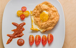 A delicious breakfast of fried eggs and tomatoes Stock Photography